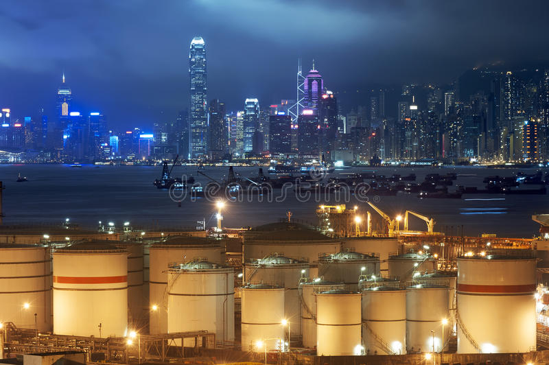 Oil storage tanks. With urban background in Hong Kong royalty free stock images