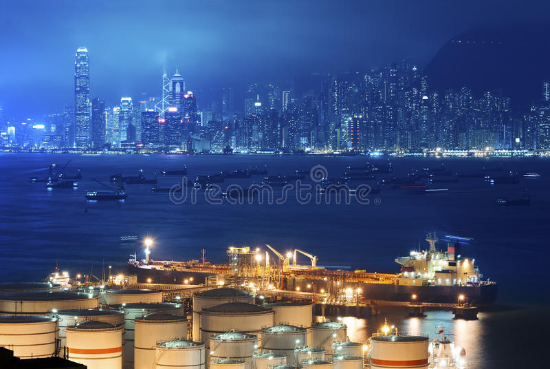 Oil Storage tanks and tanker. Oil Storage tanks with urban background in Hong Kong stock photos