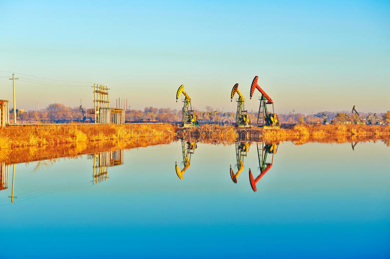 Download The Oil Sucking Machine And Inverted Image Sunrise Royalty Free Stock Photography - Image: 35532647
