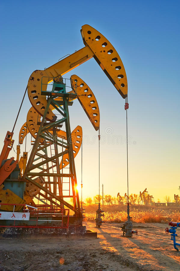 Download The Oil Sucking Machine Sunrise Stock Image - Image: 35532455