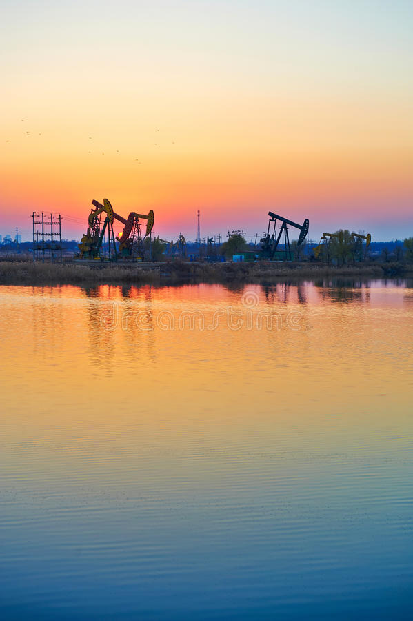 Download The Oil Sucking Machines Sunset Royalty Free Stock Photos - Image: 35532598