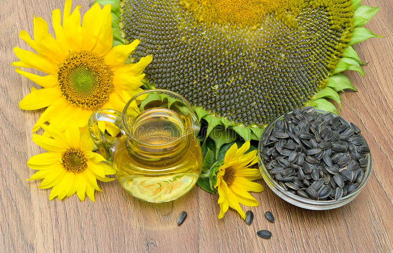 Oil and sunflower seeds, sunflowers close up. horizontal photo. Mature seeds and sunflower oil, sunflower flowers close-up. top view - horizontal photo stock photos