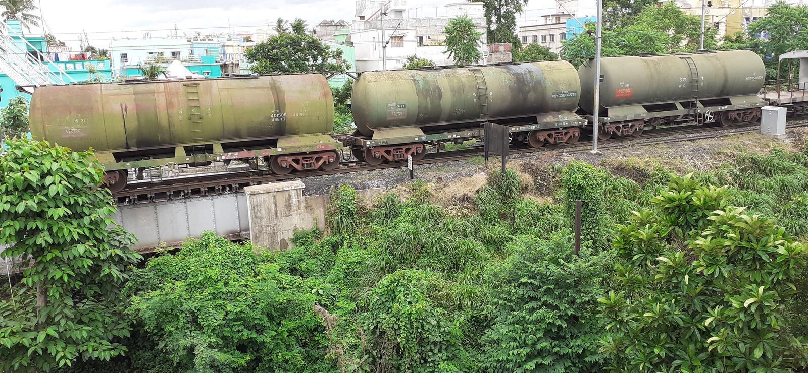 Oil tank train. A oil tank train wait for signal on the railway tracks wetting to go after passenger train royalty free stock photos
