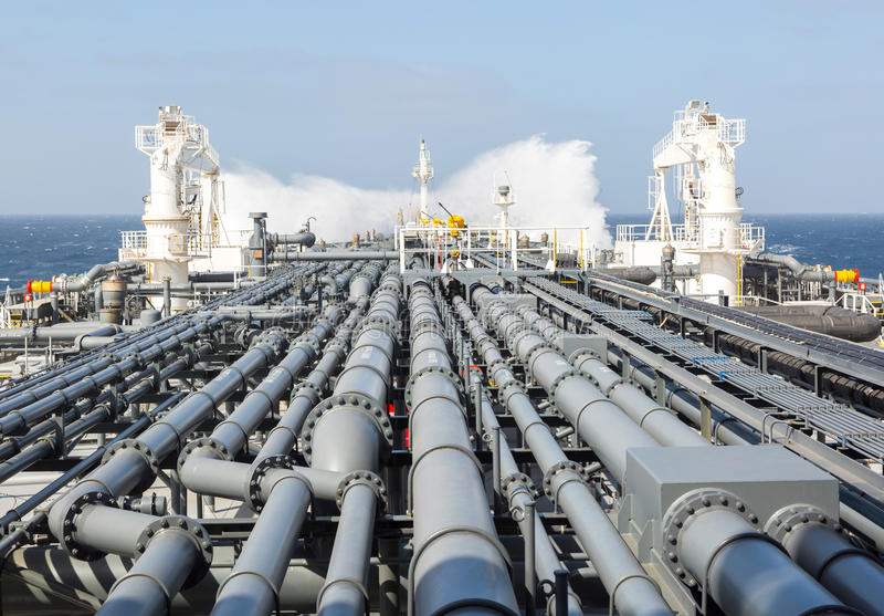 Oil tanker pipeline and breaking wave royalty free stock photography