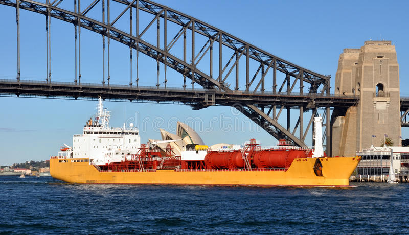 Oil Tanker Sailing Under The Sydney Harbour Bridge royalty free stock images