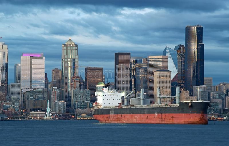 Oil tanker ship in harbour with city skyline in backdrop stock image