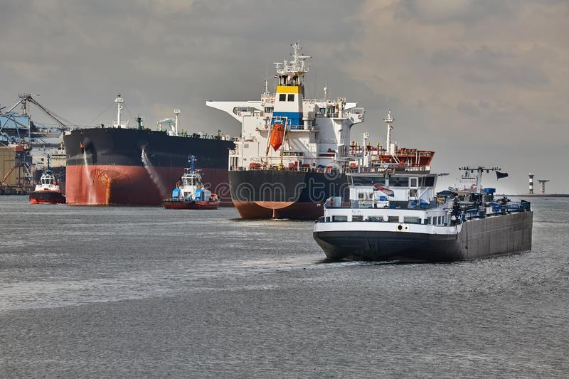 Oil Tanker Ship. Ship traffic in the busy Port of Rotterdam, large crude oil tanker ship coming into port royalty free stock images