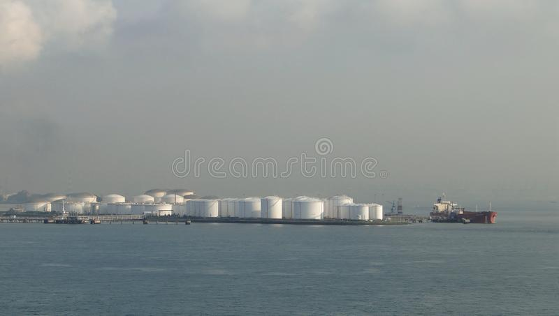 Oil tankers in unloading oil tank, oil continuously flows into the storage tanks royalty free stock images