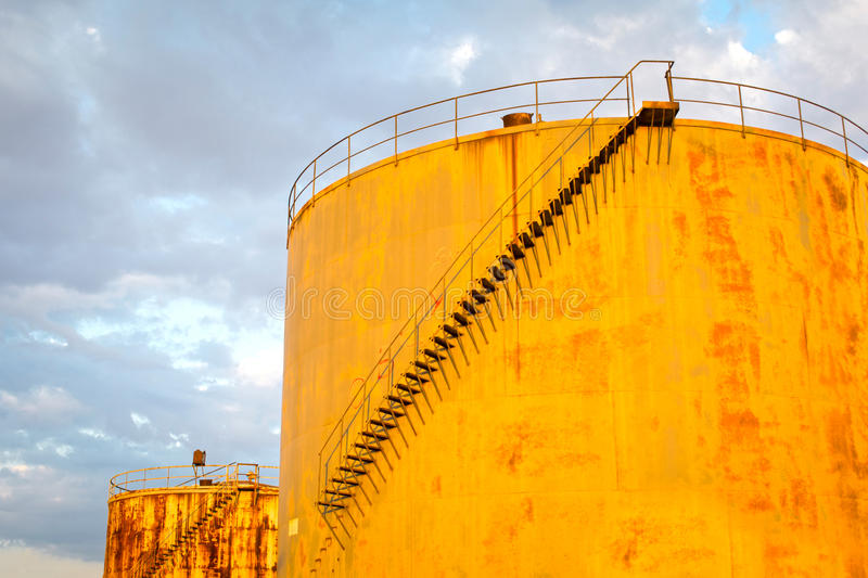 Rusty oil tanks stock image