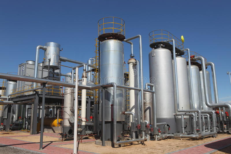 Oil tanks in a refinery. Industrial view of oil petrochemical refinery tanks royalty free stock photos