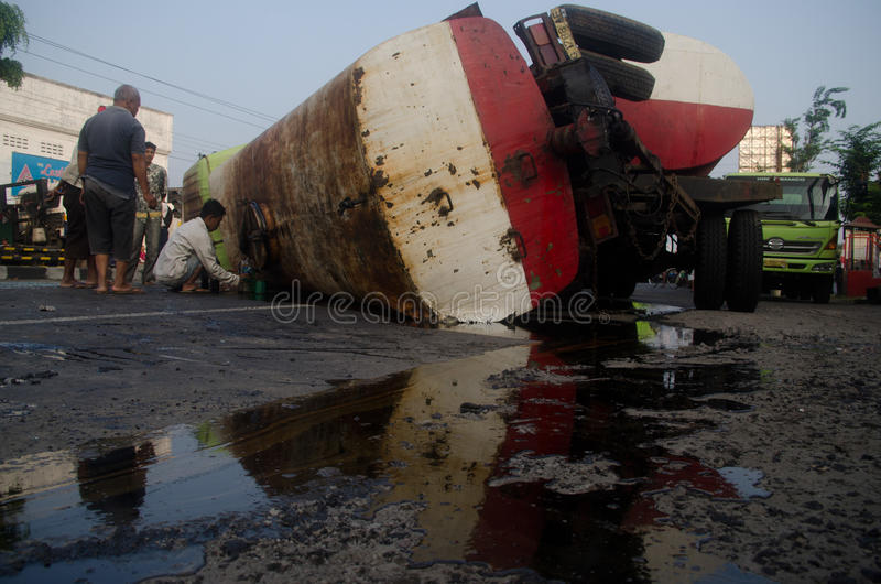 OIL TRUCK ACCIDENT. An oil carrier truck is overturned at Kartasura Street, Sukoharjo, Java, Indonesia. Exhaustion and lack of discipline are the main cause of stock photo