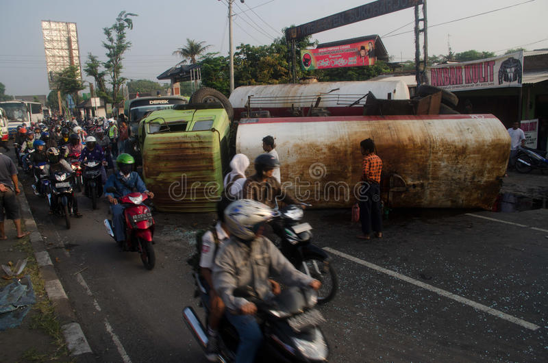 OIL TRUCK ACCIDENT. An oil carrier truck is overturned at Kartasura Street, Sukoharjo, Java, Indonesia. Exhaustion and lack of discipline are the main cause of stock image