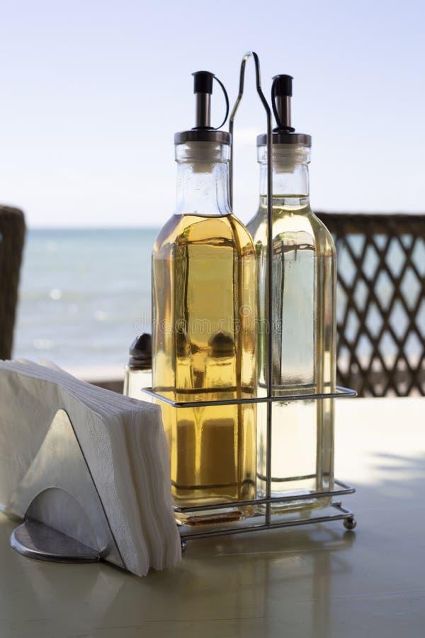 Oil and vinegar at seacoast royalty free stock image