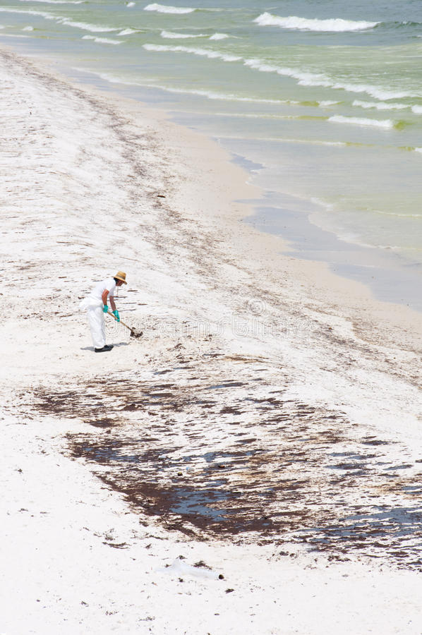 Download Oil Washes Ashore In Pensacola Beach Editorial Photo - Image of beach, sand: 14860036