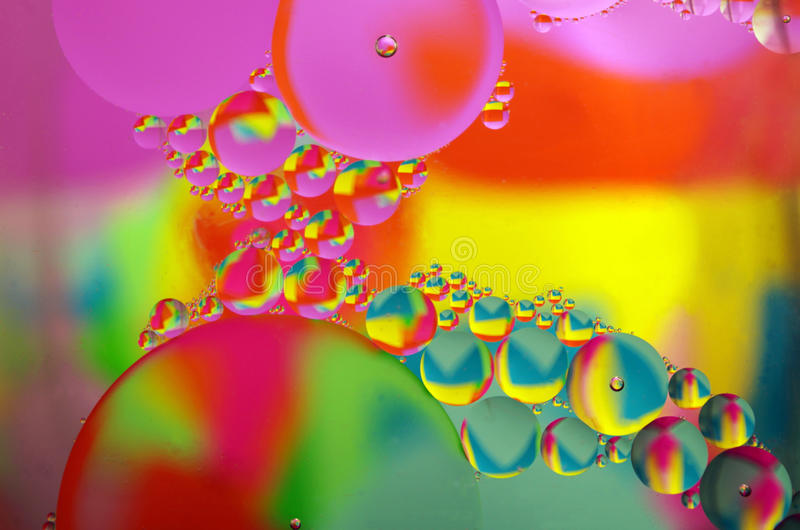 Oil in Water. Abstract macro of water droplets in oil royalty free stock photography