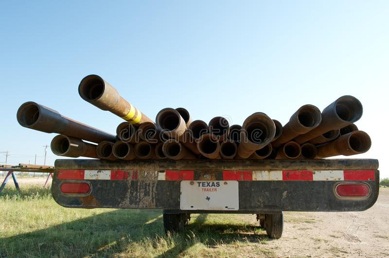 Oil well casing pipes. Metal oil well casing pipes on a trailer between San Angelo and Christoval, TX, US. Oil and gas industry royalty free stock photo