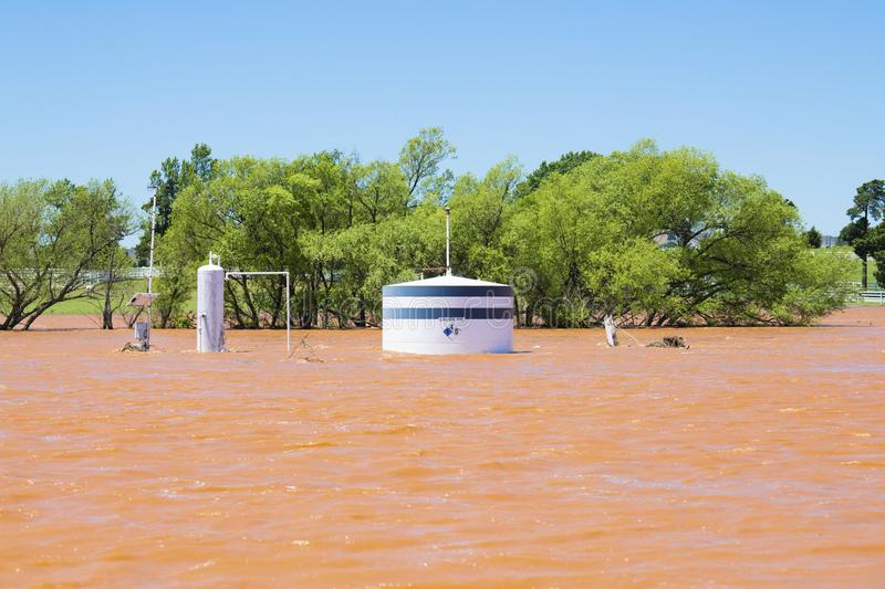 Oil well under water after flash flooding in Oklahoma stock photo