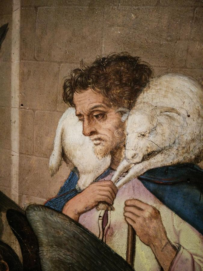 Italy. Artistic heritage. Nativity, work by Master of Bolea. Detail with a shepherd than carries a sheep on shoulders royalty free stock photography