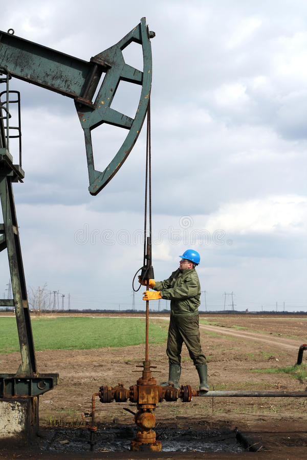 Oil worker. Standing at pipeline royalty free stock image