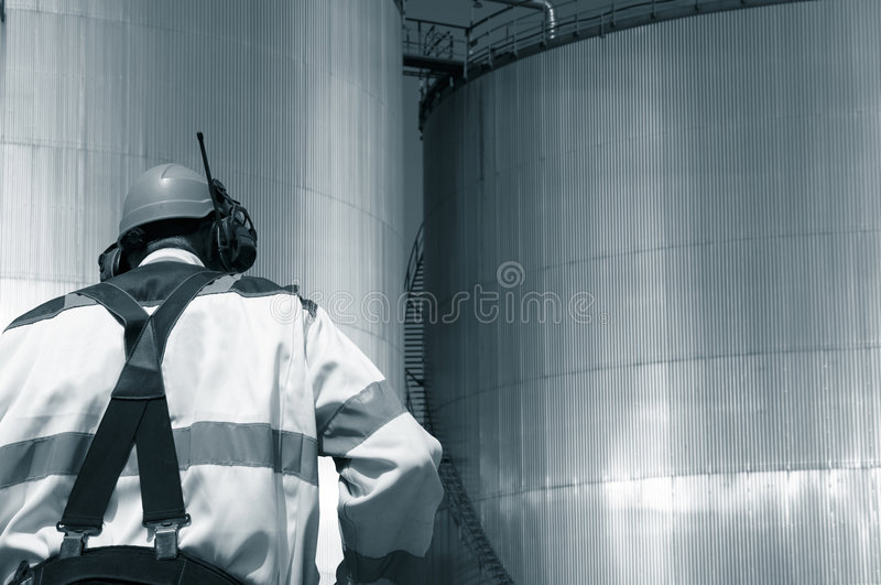 Download Oil Worker And Fuel Tanks Stock Images - Image: 5351074