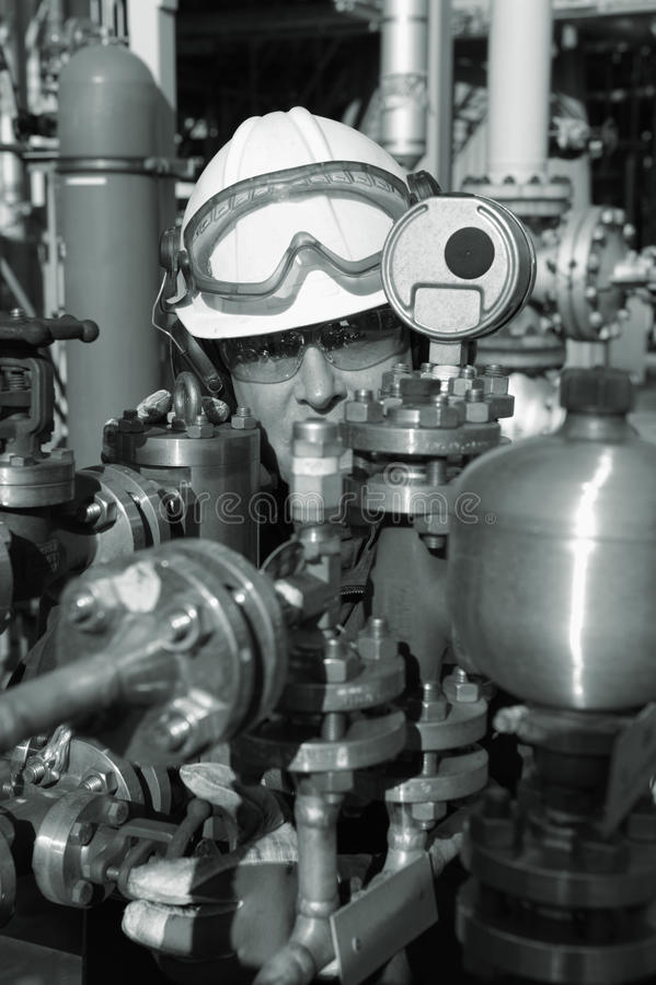 Download Oil Worker And Refinery Pipes Stock Image - Image: 20824125