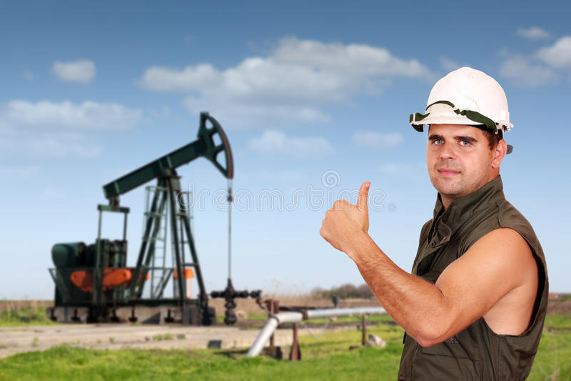 Oil worker success. Power and energy royalty free stock photography