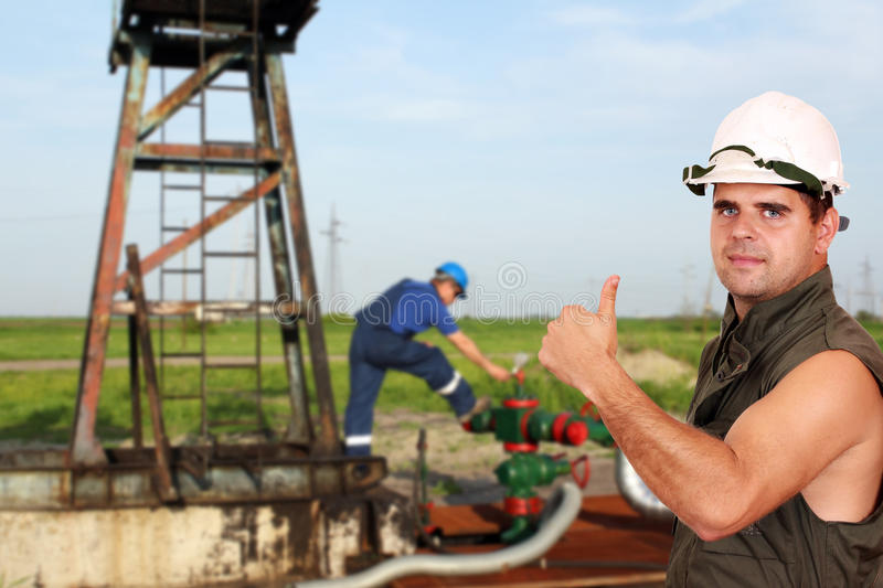Oil worker with thumb up stock image