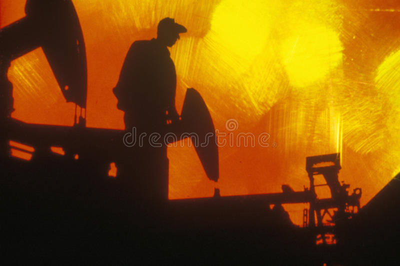 Oil worker at Torrance in Delamo County, CA royalty free stock photo