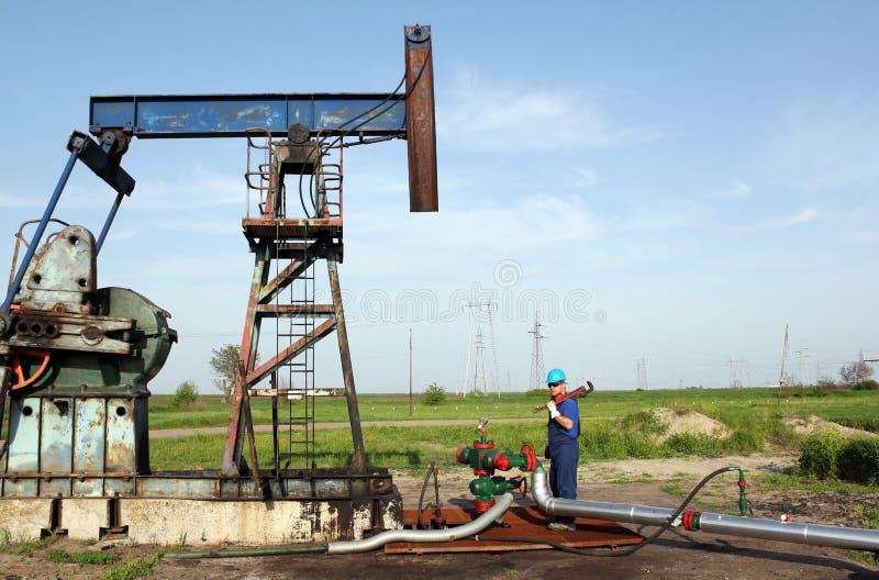 Oil worker works on pipeline. Industry scene royalty free stock image