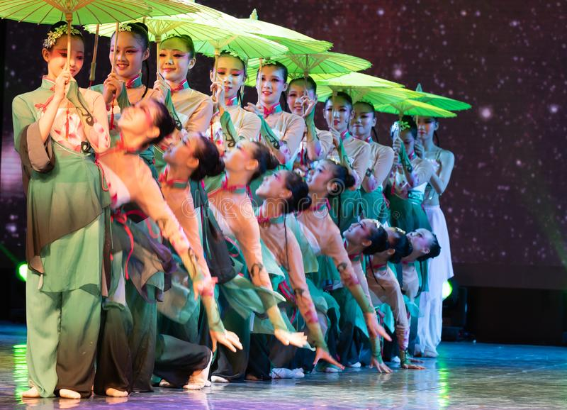 Oiled paper umbrella-In the spring of the west lake-Chinese classical dance. By the west lake in hangzhou, a pair of graceful young girls came to pick mulberry stock images