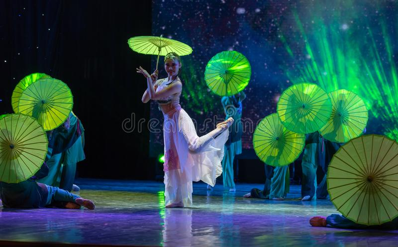 Oiled paper umbrella-In the spring of the west lake-Chinese classical dance. By the west lake in hangzhou, a pair of graceful young girls came to pick mulberry stock photos