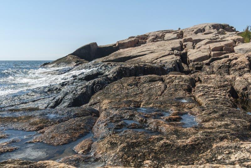 Oily coating on rocks on Narragansett Bay stock photo