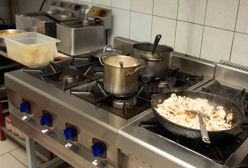 Oily and dirty gas stove in the kitchen at the restaurant catering, anti-sanitary, unsanitary conditions. Bacteria royalty free stock photos