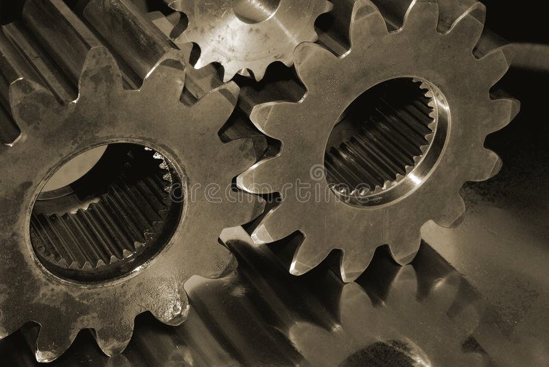 Oily gears. Various gears, cogs with an oily apperance reflecting in steel stock image