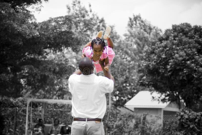 Ojca i córki bawić się fotografia stock