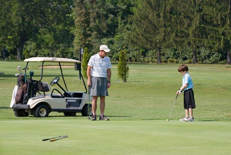 ojca syn golfowy bawić się obraz royalty free