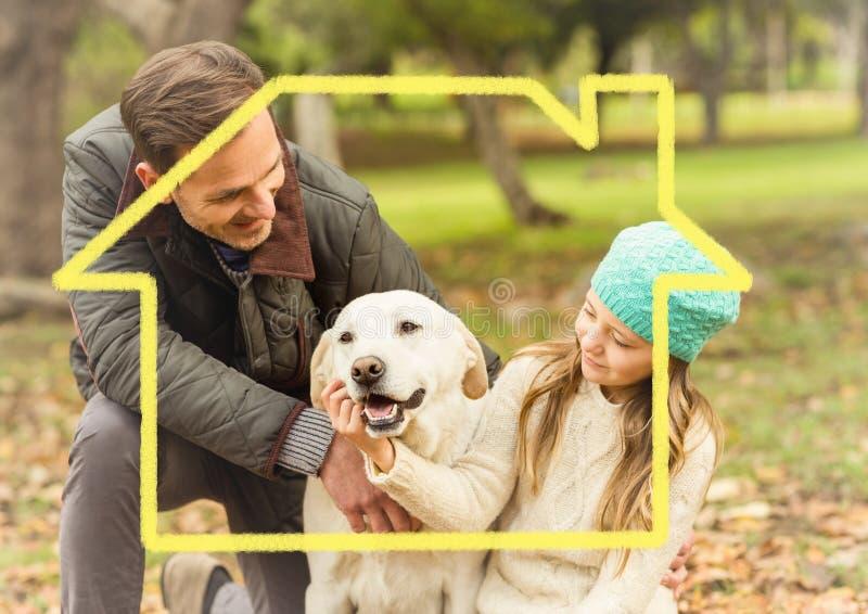 Ojciec i córka bawić się z psem w parku nad konturu dom fotografia stock