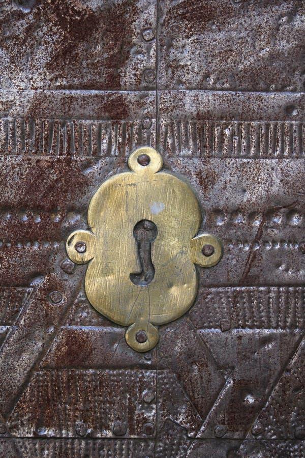 Ojo de la cerradura antiguo de la puerta fotografía de archivo libre de regalías