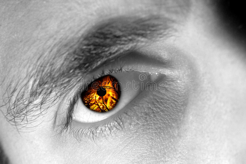 Ojo en el fuego imagen de archivo libre de regalías