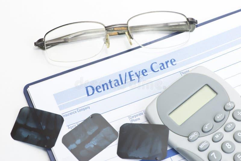 Ojo y expediente dental fotos de archivo