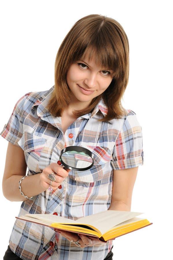 Ojo y lupa y libro fotografía de archivo libre de regalías