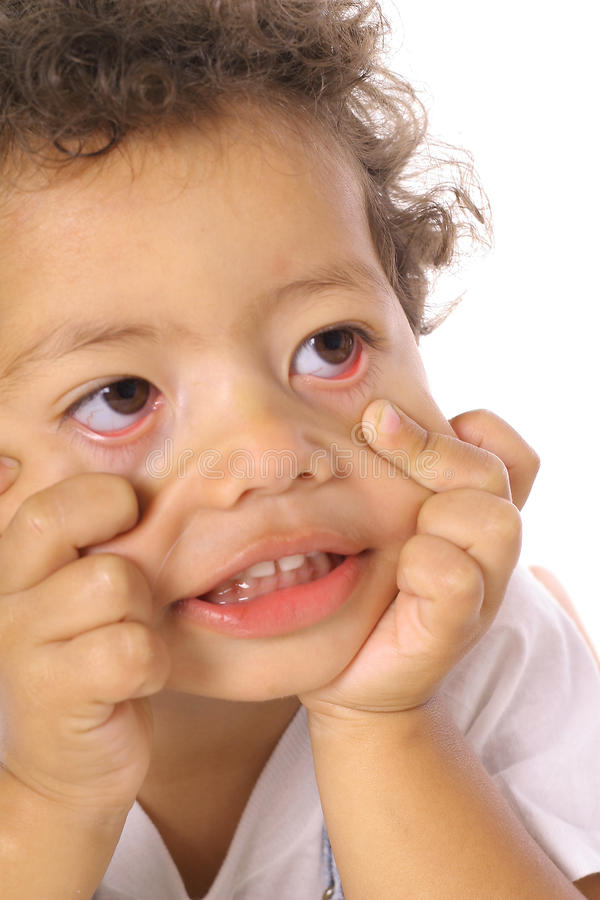 Ojos divertidos del niño de la cara fotos de archivo