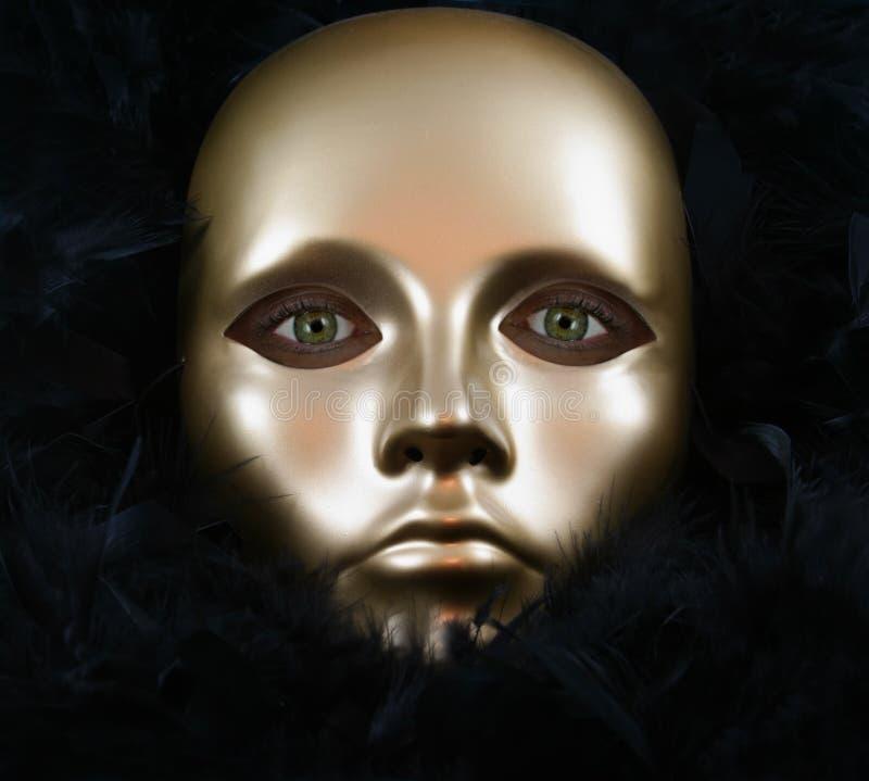 Ojos verdes y máscara del oro fotografía de archivo