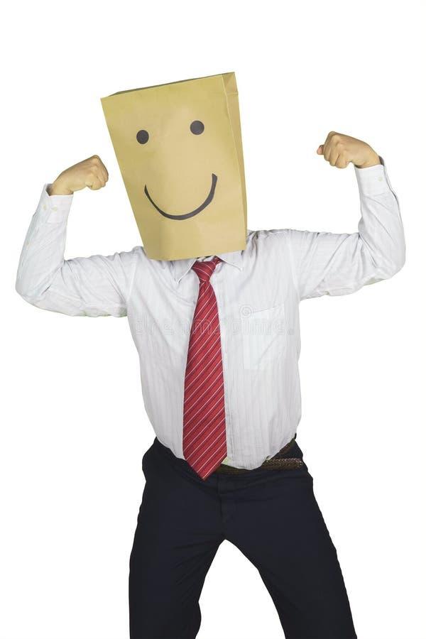 Okänd affärsman som visar hans biceps på studio arkivfoton