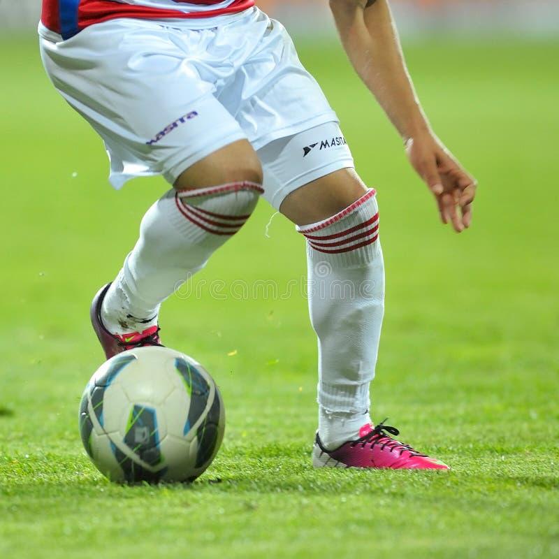 Okänd fotbollsspelare royaltyfria bilder