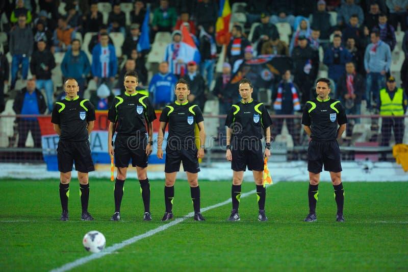 Okända fotbollsspelare utför royaltyfria foton