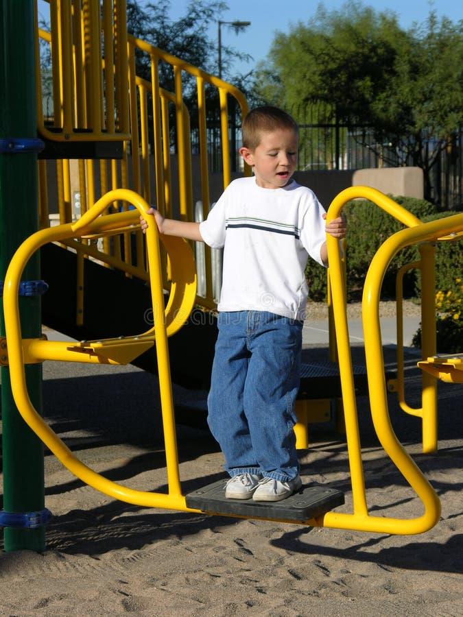 This is OK. Boy at playground stock photos