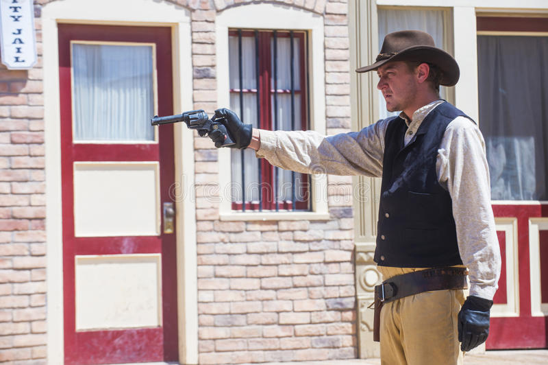 OK Corral gunfight. TOMBSTONE , ARIZONA - AUG 09 : Actor takes part in the Re-enactment of the OK Corral gunfight in Tombstone , Arizona on August 09 2014 royalty free stock photo