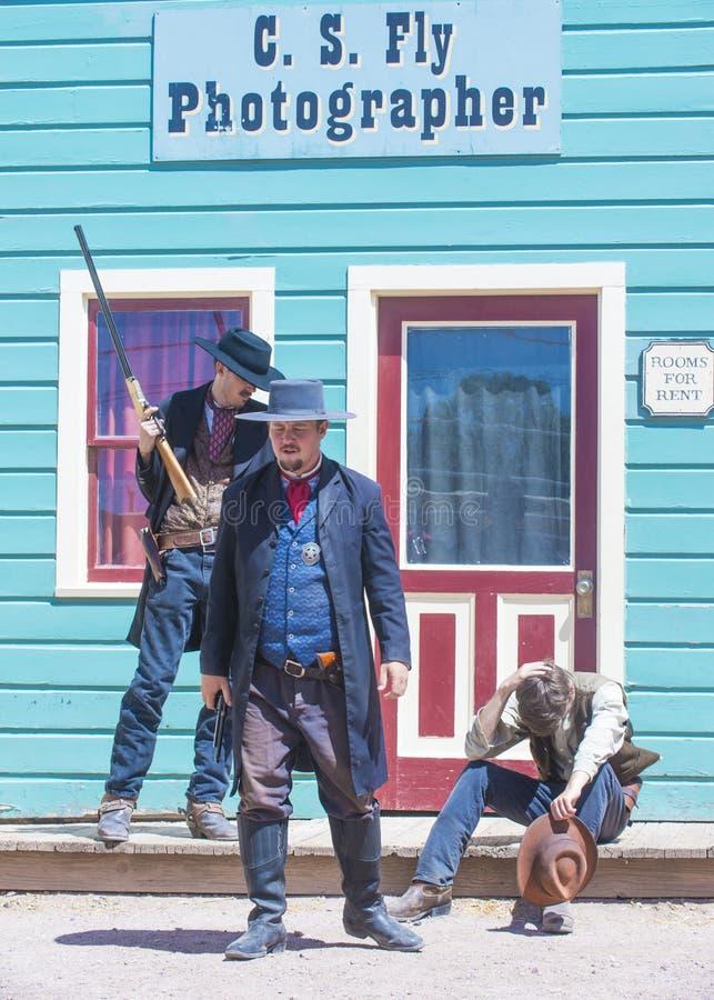 OK Corral gunfight. TOMBSTONE , ARIZONA - AUG 09 : Actors takes part in the Re-enactment of the OK Corral gunfight in Tombstone , Arizona on August 09 2014 royalty free stock photo