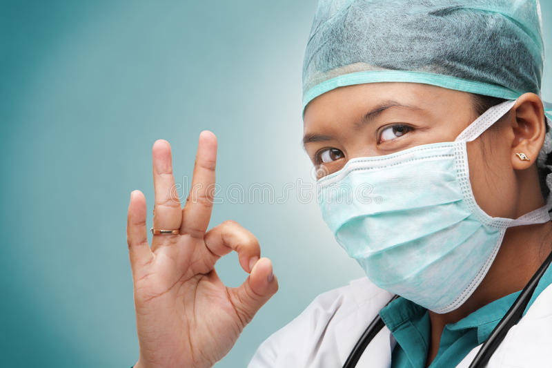ok doktorski żeński medyczny znak zdjęcie royalty free